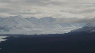 AK0001_0910 - 4K stock footage aerial video Tazlina Glacier in snow-covered Chugach Mountains near Tazlina Lake, Alaska