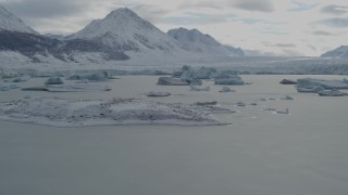 AK0001_0916 - 4K stock footage aerial video flying over glacial ice, toward edge of snow covered glacier during winter, Tazlina Lake, Alaska