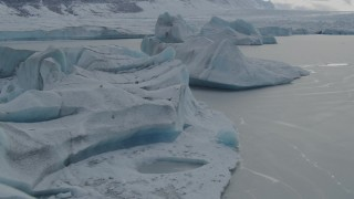 AK0001_0917 - 4K stock footage aerial video flying over snowy, glacial ice during winter in Tazlina Lake, Alaska