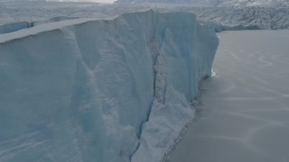 AK0001_0919 - 4K stock footage aerial video flying along the edge of the snow-covered Tazlina Glacier, Alaska
