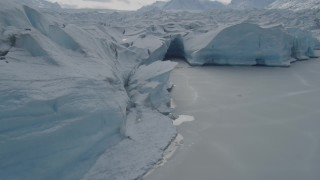AK0001_0920 - 4K stock footage aerial video flying over the edge of snow covered Tazlina Glacier, Alaska