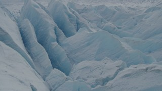 AK0001_0922 - 4K stock footage aerial video flying over snow covered surface of the Tazlina Glacier, Alaska