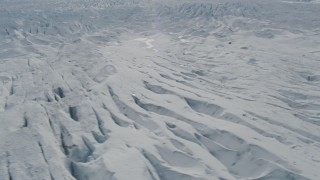 AK0001_0924 - 4K stock footage aerial video flying over snow covered surface of the Tazlina Glacier, Alaska