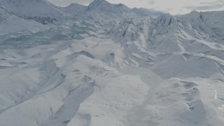 AK0001_0925 - 4K stock footage aerial video flying over snow covered surface of the Tazlina Glacier, Alaska