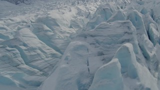 AK0001_0926 - 4K stock footage aerial video flying over snow covered surface of the Tazlina Glacier, Alaska