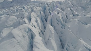 AK0001_0928 - 4K stock footage aerial video flying over snow covered surface of the Tazlina Glacier, Alaska