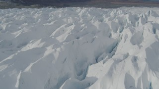AK0001_0932 - 4K stock footage aerial video flying over snow covered surface of the Tazlina Glacier, Alaska