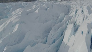 AK0001_0933 - 4K stock footage aerial video flying over snow covered surface of the Tazlina Glacier, Alaska