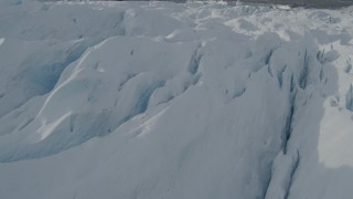 AK0001_0934 - 4K stock footage aerial video flying over snow covered surface of the Tazlina Glacier, Alaska