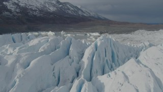 AK0001_0935 - 4K stock footage aerial video flying over snow covered surface of the Tazlina Glacier, tilt down, Alaska