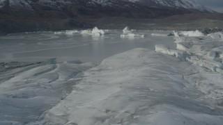 AK0001_0936 - 4K stock footage aerial video flying over snow covered glacier edge, past ice in Tazlina Lake, winter, Tazlina Glacier, Alaska