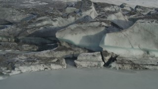 AK0001_0937 - 4K stock footage aerial video flying low over the dirty, snowy edge of Tazlina Glacier, Alaska