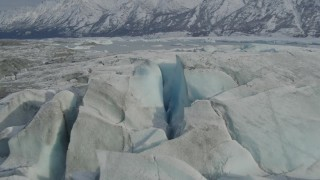AK0001_0938 - 4K stock footage aerial video approaching Tazlina Lake, during winter, over icy, snow covered surface of Tazlina Glacier, Alaska