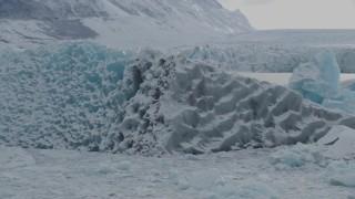 AK0001_0945 - 4K stock footage aerial video orbiting glacial ice, in snow, during winter, Tazlina Lake, Alaska