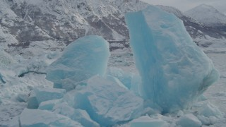 AK0001_0947 - 4K stock footage aerial video fly by glacial ice near edge of glacier, during winter, in snow, Tazlina Lake, Alaska