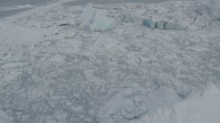 AK0001_0948 - 4K stock footage aerial video flying over snow covered glacier edge and Tazlina Lake during winter, Tazlina Glacier, Alaska
