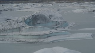 AK0001_0949 - 4K stock footage aerial video flying over snow covered glacial ice during winter, Tazlina Lake, Alaska