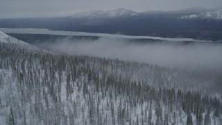 AK0001_0964 - 4K stock footage aerial video approach Saint Anne Lake, through mist above snowy Chugach Mountains, Alaska