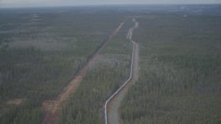 AK0001_0983 - 4K stock footage aerial video flying over pipeline, revealing forest during winter, Trans-Alaska Pipeline, Alaska