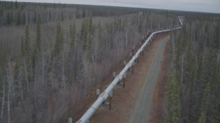 AK0001_0998 - 4K stock footage aerial video pan across the pipeline during winter, Trans-Alaska Pipeline, Alaska