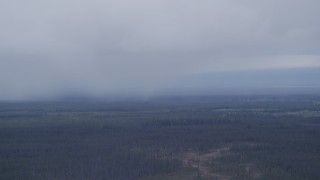AK0001_1021 - 4K stock footage aerial video flying away from low clouds over forest, Alaskan Wilderness
