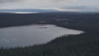 AK0001_1028 - 4K stock footage aerial video flying over a small lake towards Tazlina Lake, Alaska