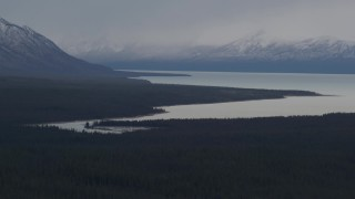 AK0001_1029 - 4K stock footage aerial video Tazlina Lake bordered by forest and snow capped Chugach Mountains, Alaska