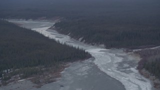 AK0001_1044 - 4K stock footage aerial video the icy Tazlina River surrounded by evergreen forest, Alaska
