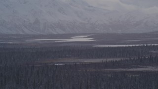 AK0001_1052 - 4K stock footage aerial video Lake Leila and Trail Lake at base of snow covered Chugach Mountains, Alaska