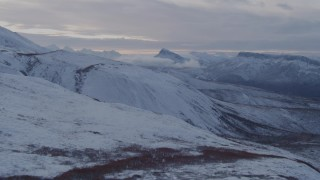 AK0001_1060 - 4K stock footage aerial video flying over snowy slopes and jagged peaks in the Talkeetna Mountains, Alaska