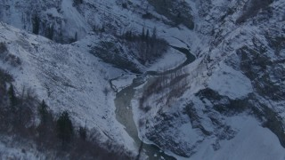 AK0001_1066 - 4K stock footage aerial video following a river in a snow covered canyon, Talkeetna Mountains, Alaska