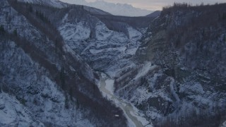 AK0001_1068 - 4K stock footage aerial video following river at bottom of snow covered canyon, Talkeetna Mountains, Alaska