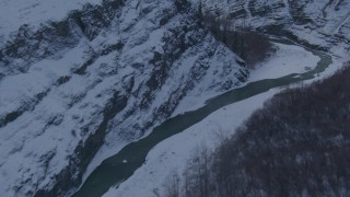 AK0001_1069 - 4K stock footage aerial video a river at the bottom of a canyon, snowy cliffs, Talkeetna Mountains, Alaska