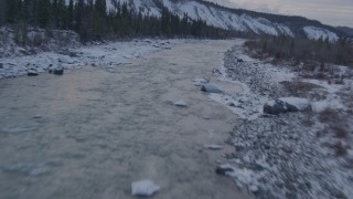 AK0001_1075 - 4K stock footage aerial video following the Matanuska River and snow covered shore, Alaska