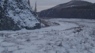 AK0001_1077 - 4K stock footage aerial video flying low over surface of Matanuska River and snow covered shore, Alaska