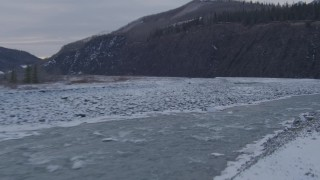 AK0001_1078 - 4K stock footage aerial video following the Matanuska River and snow covered shore, Alaska