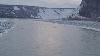 AK0001_1080 - 4K stock footage aerial video flying over the Matanuska River and snow covered bank, Alaska