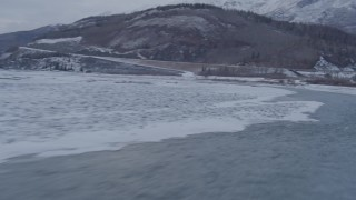 AK0001_1082 - 4K stock footage aerial video racing low over surface of Matanuska River in snow covered ground, Alaska