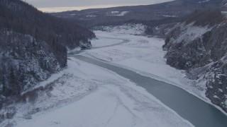 AK0001_1084 - 4K stock footage aerial video fly over the Matanuska River and snowy Matanuska River Valley, Alaska