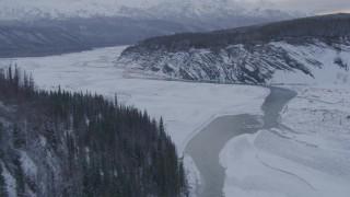 AK0001_1085 - 4K stock footage aerial video tilt from a bird's eye view of the snow covered Matanuska River Valley, Alaska
