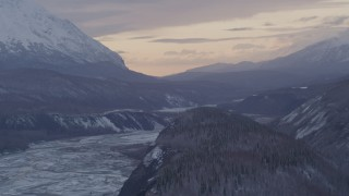 AK0001_1099 - 4K stock footage aerial video snowy Matanuska River Valley and mountains at twilight, Alaska