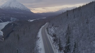 AK0001_1102 - 4K stock footage aerial video Glenn Highway toward King Ranch, snow on ground, Sutton, Alaska, twilight