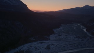 AK0001_1106 - 4K stock footage aerial video flying over the snow covered Matanuska River Valley at sunset, Alaska