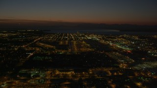 AK0001_1145 - 4K stock footage aerial video approaching Merrill Field, Downtown Anchorage at night, Alaska