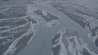 AK0001_1216 - 4K stock footage aerial video flying over Knik River in snow covered Knik River Valley, Alaska