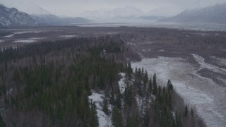 AK0001_1226 - 4K stock footage aerial video flying over wooded hills near a river, Knik River Valley, Alaska