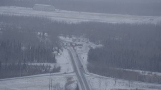 AK0001_1319 - 4K stock footage aerial video a checkpoint on D Street near Bryant Army Heliport in snow, Anchorage, Alaska