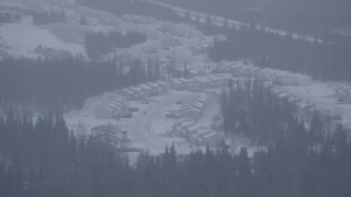 AK0001_1321 - 4K stock footage aerial video a neighborhood and trees in falling snow, Anchorage, Alaska