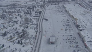 AK0001_1325 - 4K stock footage aerial video follow Penland Parkway to reveal snowy Merrill Field, Anchorage, Alaska