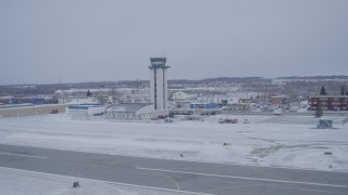 AK0001_1328 - 4K stock footage aerial video the Merrill Field control tower in snow, Anchorage, Alaska
